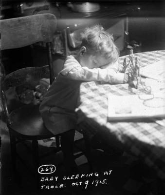 "(""Baby Sleeping at Table 1915? courtesy of Thomas Kempland)"