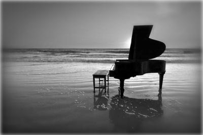 Unknown, baby grand piano on beach