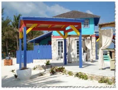 Photo by Tom Dean Colorful Beach Hut Bahamas